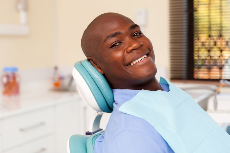 Young man smiling before tooth extraction surgery